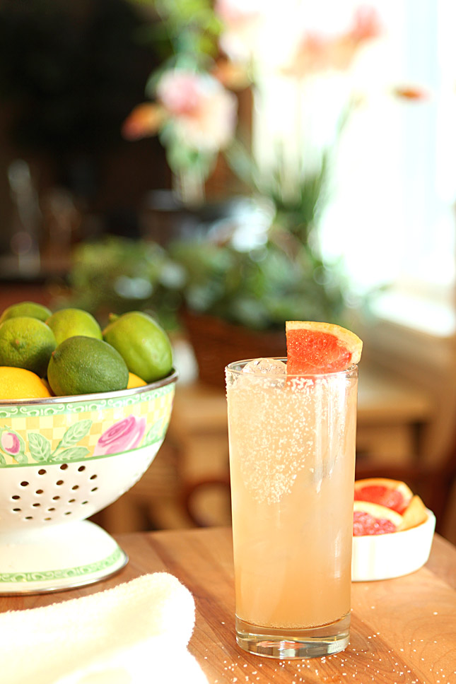 The Paloma Cocktail on a Table with a Basket of Lemons and Limes