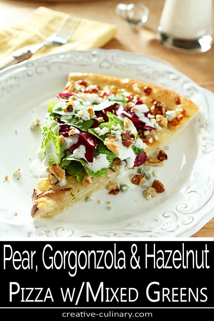 Pear Gorgonzola and Walnut Pizza Slice with Mixed Greens on a White Plate.