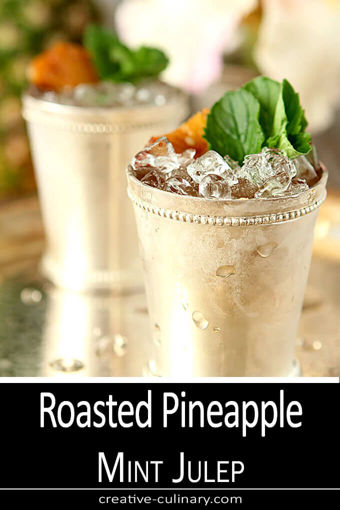 Rum Served the standard silver mint julep cup with mint and pineapple garnish.