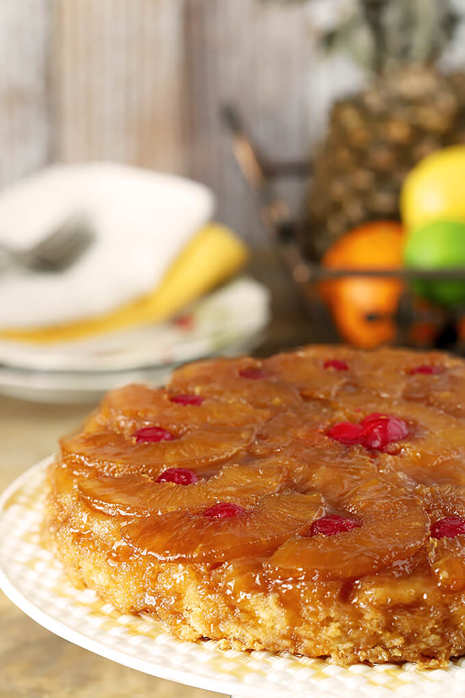 Pineapple Upside Down Cake with Rum on a Table with Plates and Napkins