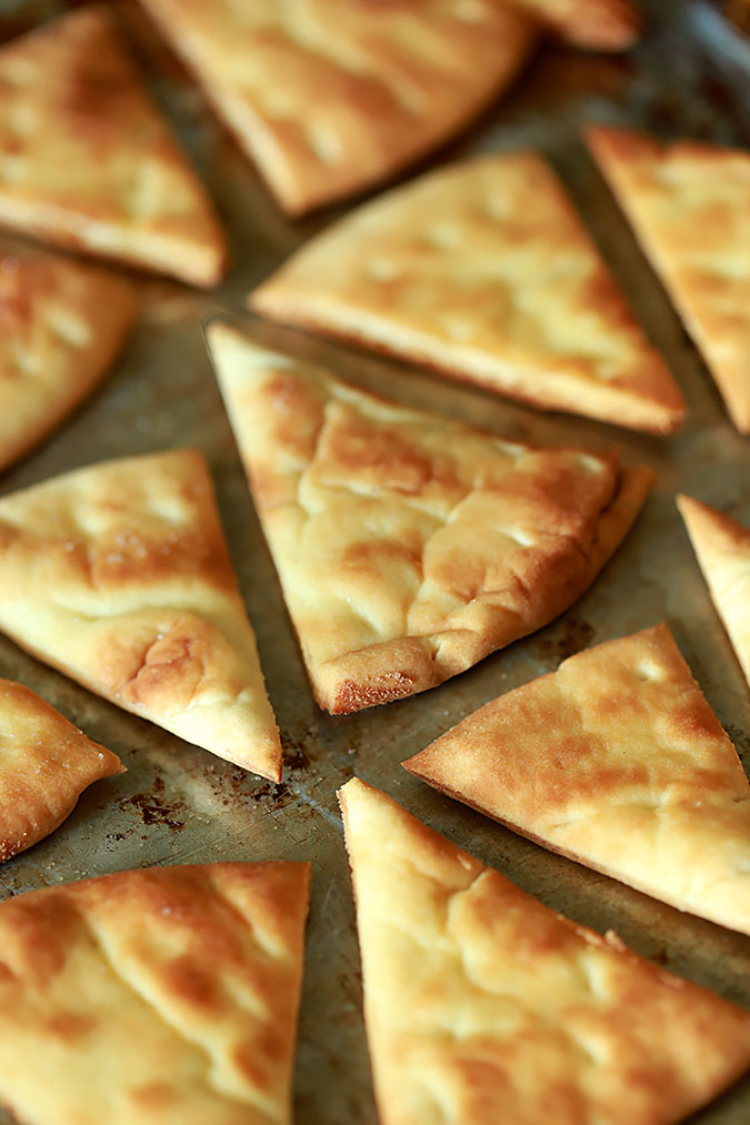 A baking tray of toasted Pita trianges