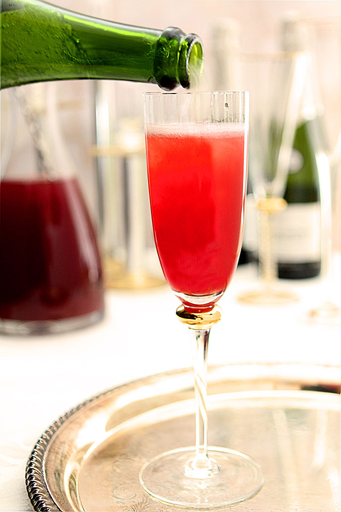 Pomegranate and Blood Orange Mimosa Cocktails Being Prepared