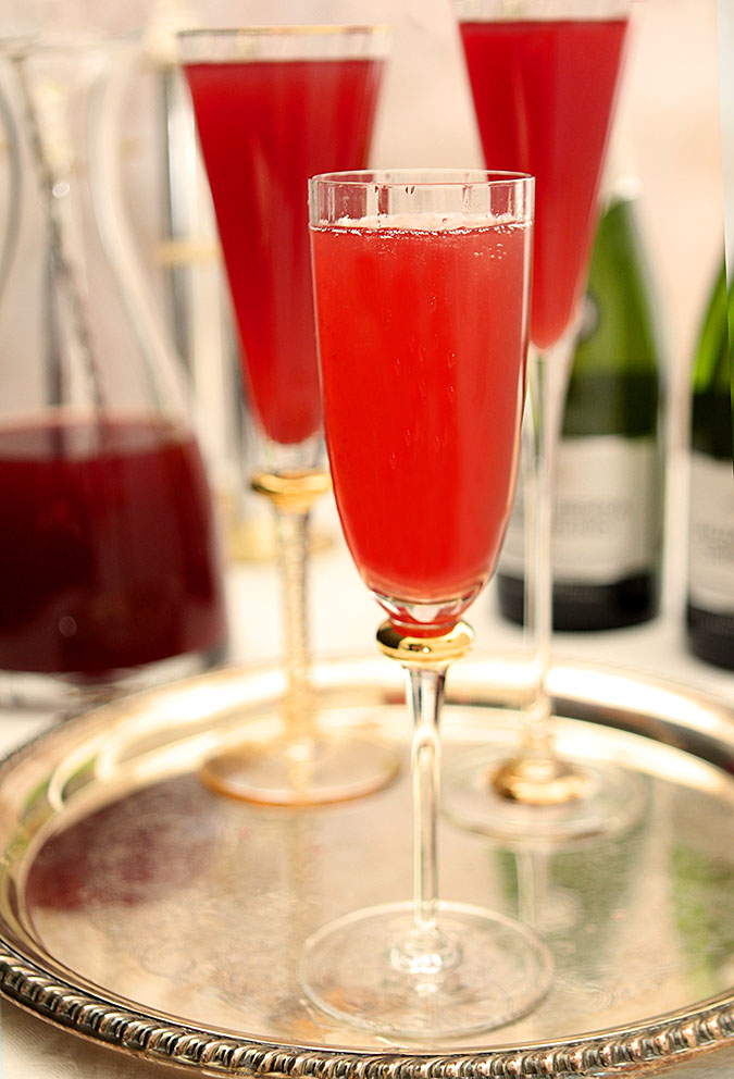 Pomegranate and Blood Orange Mimosa Cocktails Served on a Tray