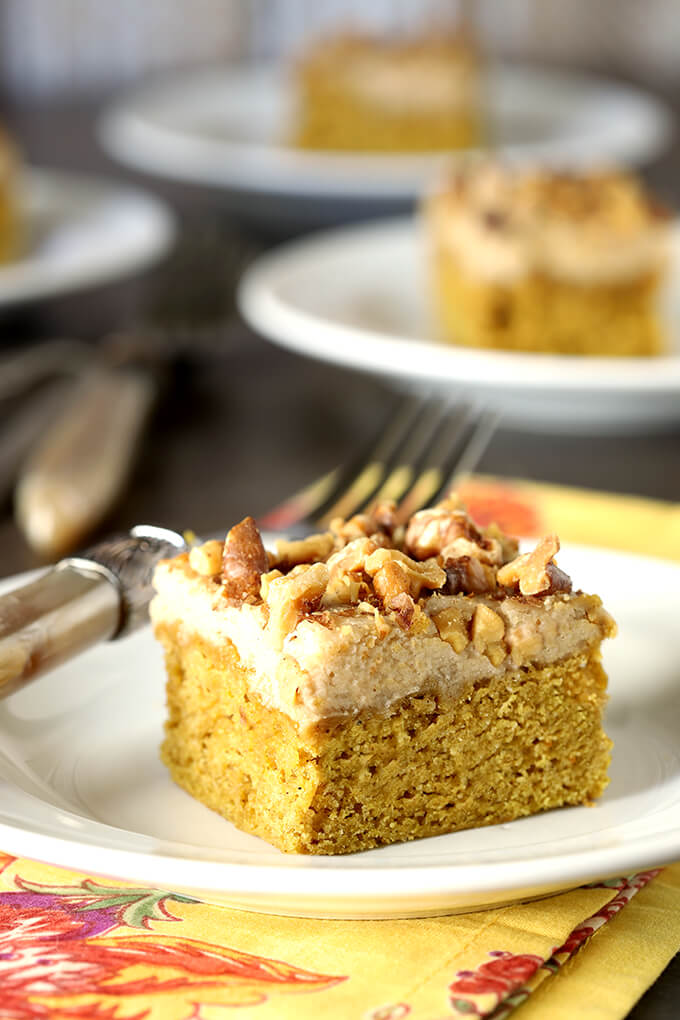 Pumpkin Bars with Maple Frosting and Toasted Walnuts on White Plate with a Fork