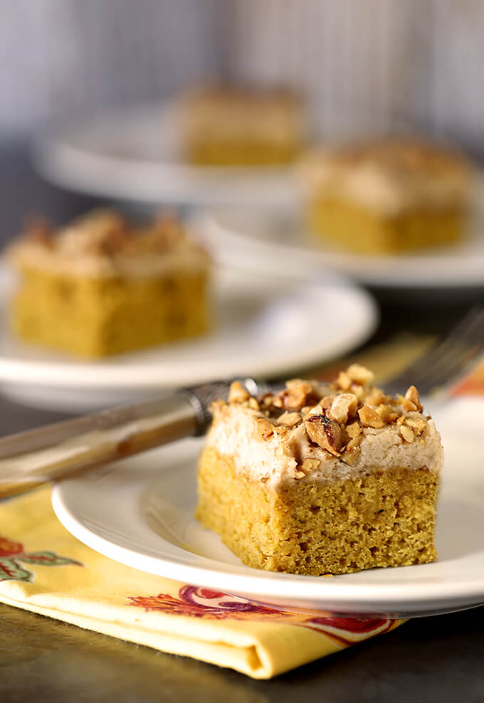 Pumpkin Bars with Maple Frosting and Toasted Walnuts Served for Company on White Plates