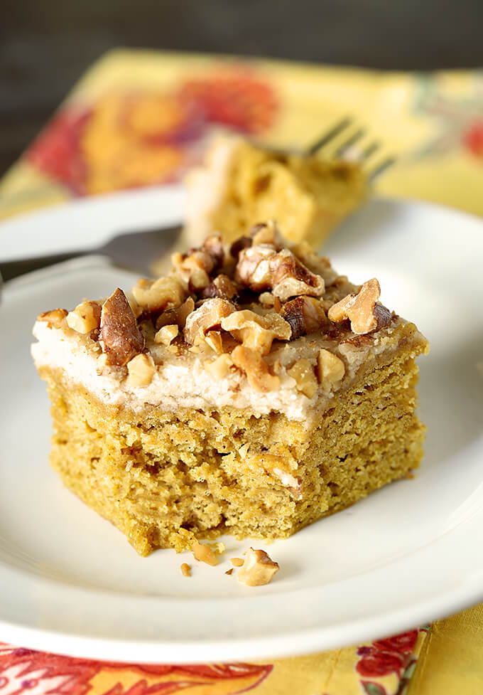 Pumpkin Bars with Maple Frosting and Toasted Walnuts on a Plate with a Bite Removed