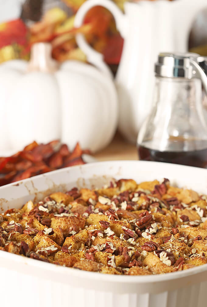 Pumpkin Pecan Overnight French Toast with Bourbon PIN in a White Ceramic Baking Dish
