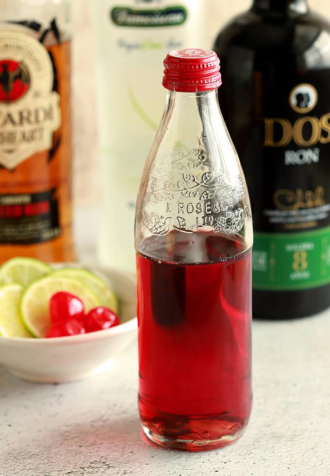 Homemade Grenadine in a small bottle.
