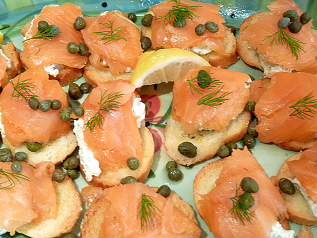 Smoked Salmon and Cream Cheese combined with Dill and Capers on a Colorful Platter.