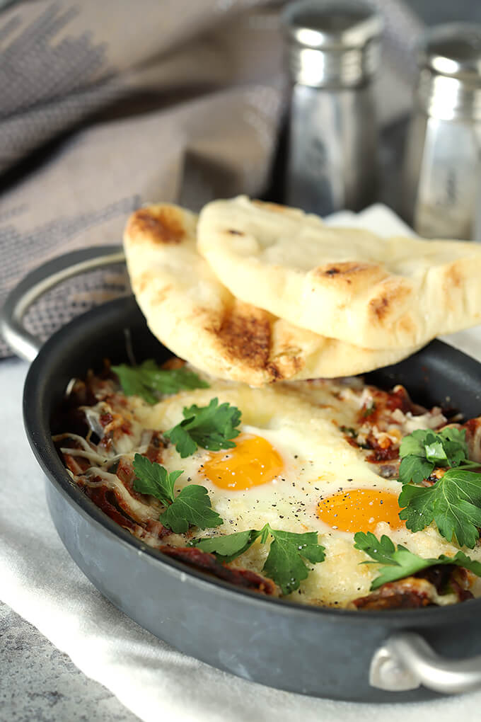 Shakshuka with Zucchini and Mushrooms In Skillet with Naan Bread