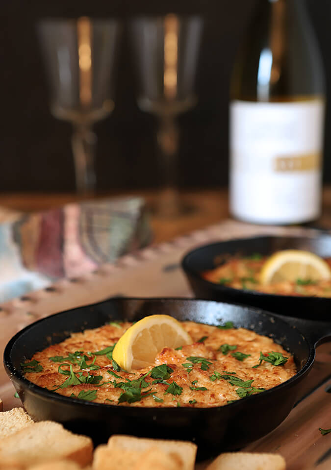 Small Cast Iron Skillets with a Shrimp Scampi and Parmesan Cheese Dip.