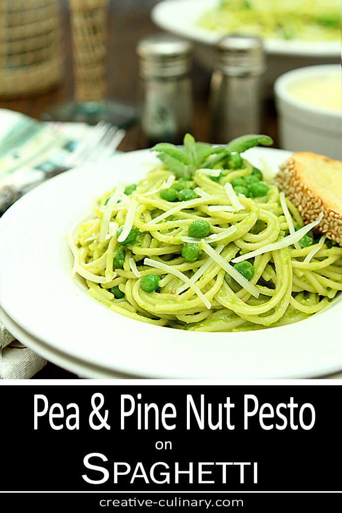 Pea and Pine Nut Pesto Served on Spaghetti in a White Bowl