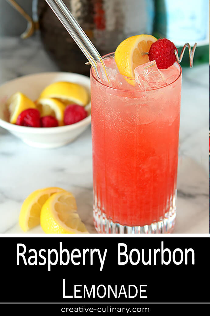 Sparkling Raspberry Bourbon Lemonade Cocktail in a Highball Galss with Lemon Slice and Raspberry Garnish