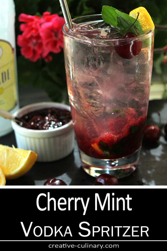 Cherry Mint Vodka Spritzer is Served in a Tall Glass with Cherry Preserves, Lemon and MInt.