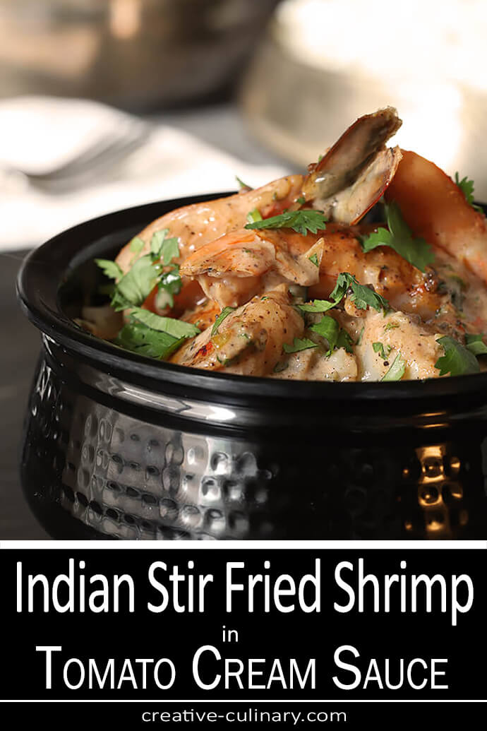 Indian Stir Fried Shrimp in a Tomato Cream Sauce in an Authentic Indian Black Bowl