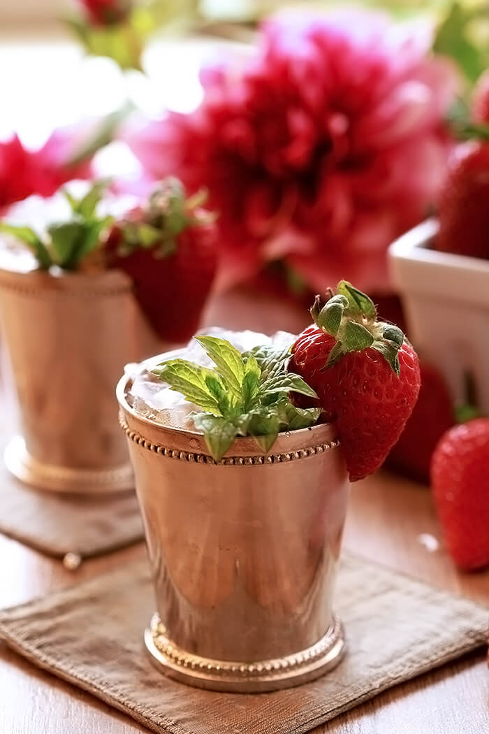Strawberry Mint Julep Cocktail in Silver Cup with Strawberry and Mint Garnish