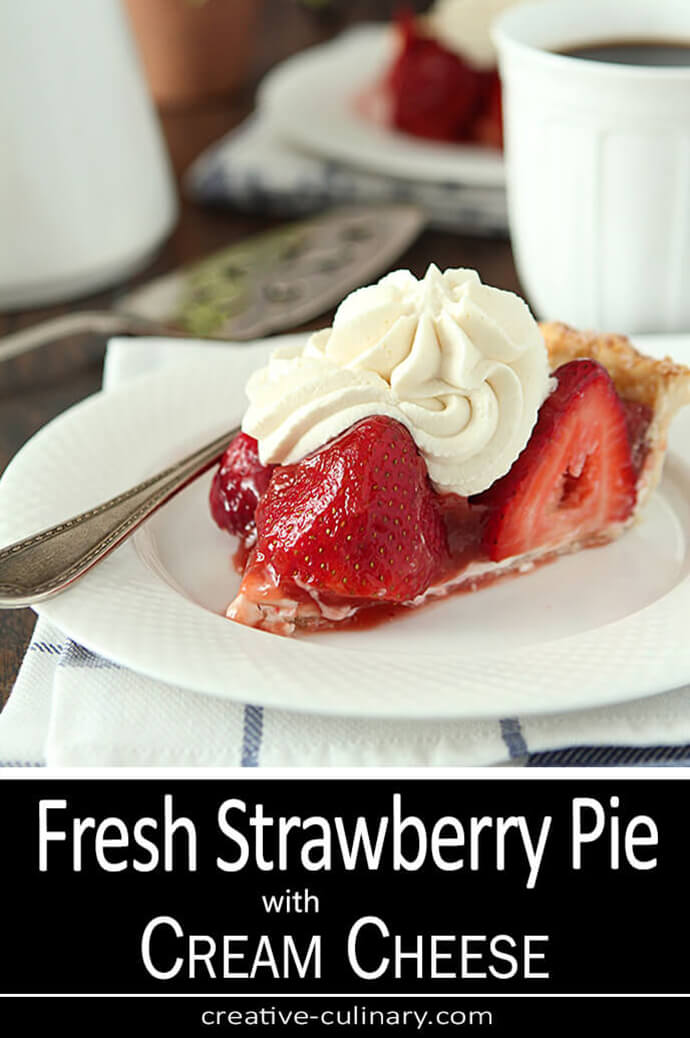 Fresh Strawberry Pie with Cream Cheese topped with whipped cream and served on a white plate.