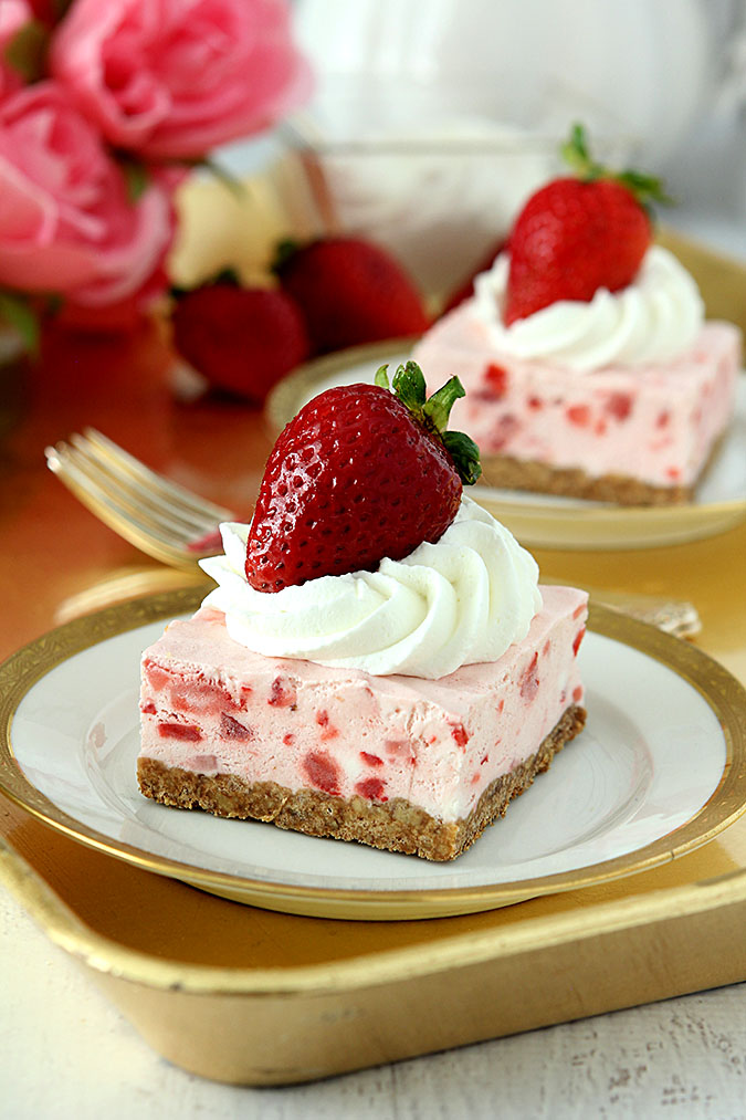 Old Fashioned Frozen Strawberry Squares Served on a White Plate Trimmed in Gold
