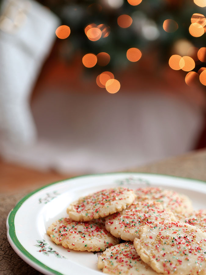 Round Sugar Cookies decorated with red, green, gold and white sugars.