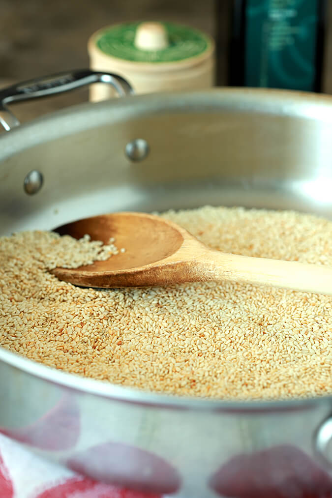 Sesame seeds in a skillet browning for Tahini - Toasted Sesame Paste