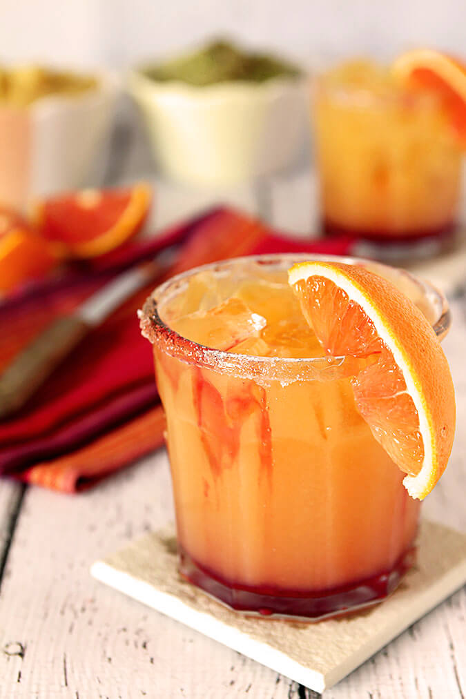 Tequila Sunrise Margarita with an Orange Section for Garnish