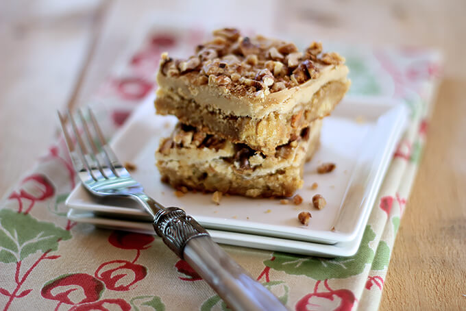 Toffee Apple Bars with Caramel Frosting on a Square WHite Serving Plate