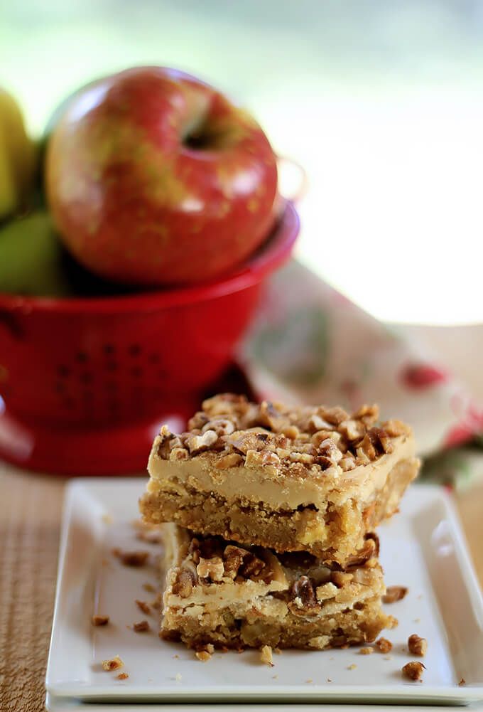 Toffee Apple Bars with Caramel Frosting Served on a White Plate