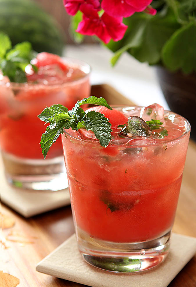 Watermelon Mint Mojito Cocktails are served in lowball glasses and garnished with mint.