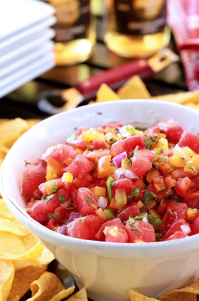 Watermelon Salsa (Pico de Gallo) Closeup of dish with watermelon, red, orange, and yellow bell peppers, and jalapeno mixed with honey.